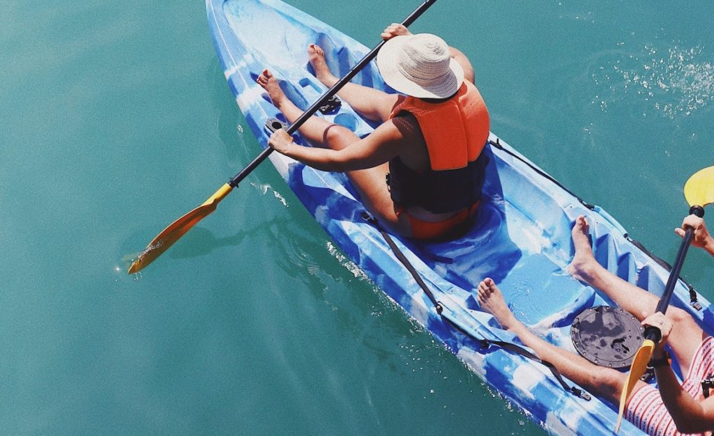 Two people are sitting on the Kayak